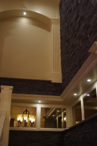 LED puck lighting set into stairwell niches